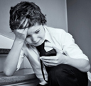 young boy receiving a bullying sms